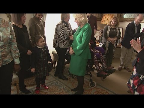 Children help Camilla decorate Clarence House Christmas tree