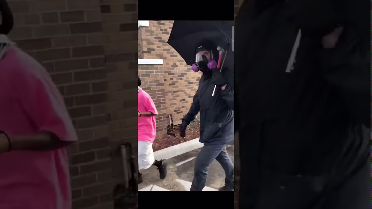 Suspicious Man Breaks Window & Starts Minneapolis Riots