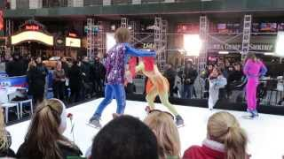 Sara Haines and Ginger Zee acting goofy while skating at Times Square with Sasha Cohen