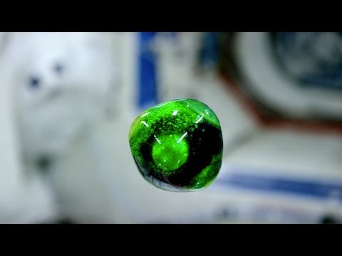 Floating balls of colored fluid in space, in 4K