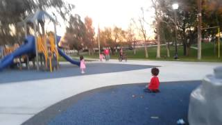Two and One Year Old Child / Toddler Playing at the Playground