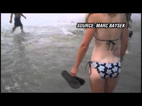 CAUGHT ON CAM: Man catches shark in Holden Beach