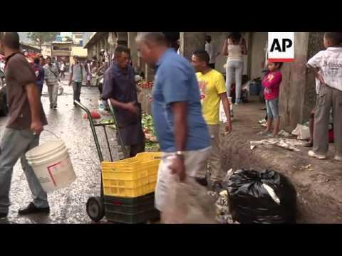 Venezuelans hit by poverty sift market rubbish