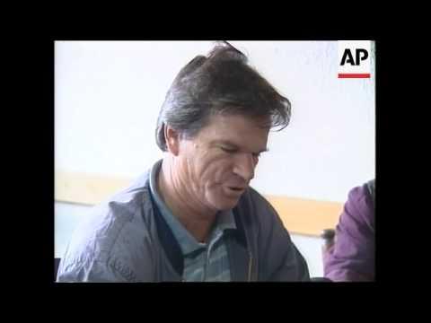 Kosovar Albanians watch Milosevic court appearance