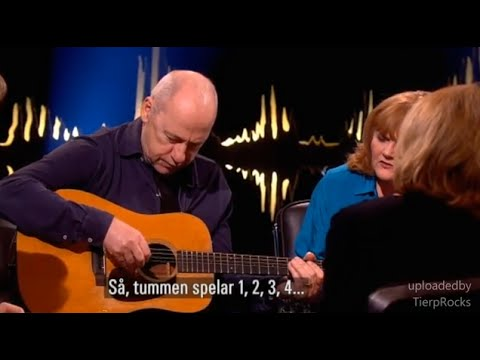 Mark Knopfler - Shows how to play guitar finger picking style Skavlan 2015