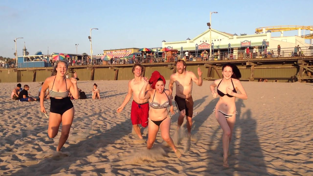 Some Cool Kids Running On The Beach