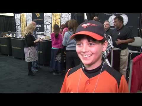 Young Collector Buys First Baseball Commemorative Coin. VIDEO: 2:01.