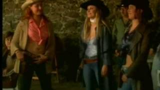 Sexy cowgirls gunfight - shooting a cowboy