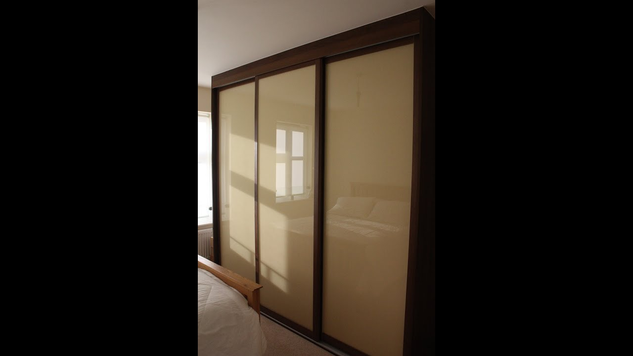 Fitted sliding door wardrobe dark walnut light brown for Built in sliding doors