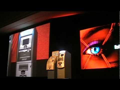 SecurityWeek.Com - Barnaby Jack Hacks ATM At Black Hat