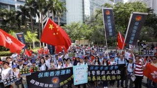 Hong Kong residents voice support for police at police headquarters