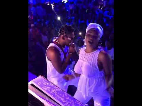 Braless Lady dances seductively with orezi on stage