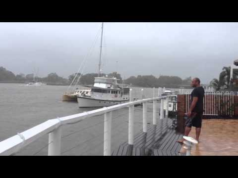 """""""Anchored"""" boat floating down Mooloolaba canal 27th Jan 2013"""