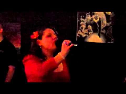 Lori Benkowski  singing at the ric rac Karaoke