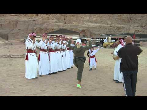 Bedouin musicians welcome travelers to Jordan's Wadi Rum Valley for barbecue dinner