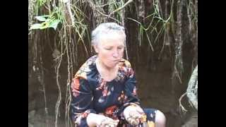 weirdy woman eating sand