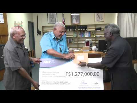 Fijian Prime Minister receives cheque from Solomon Island  Prime Minister