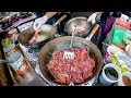 Food from Thailand, Cooked and Tasted in Greenwich Market. London Street Food