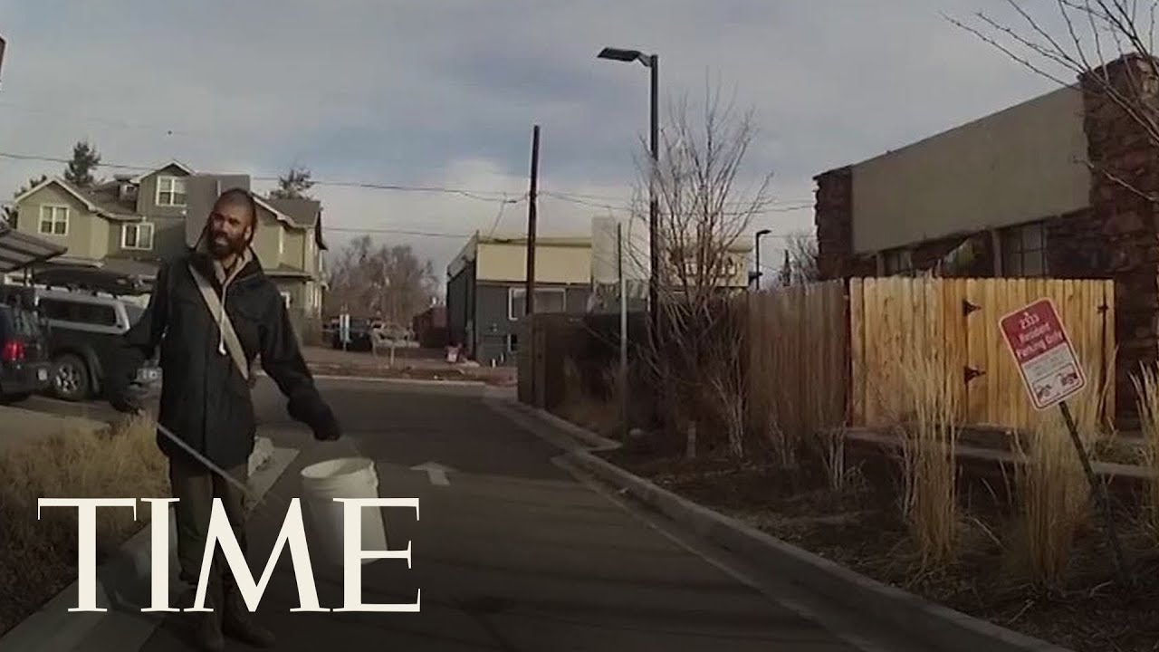 A person picking up trash colorado police confronts