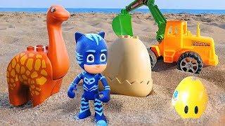 Фото Для самых маленьких. Мультики для малышей песочница экскаватор и динозаврик. Прячем яйца в песке