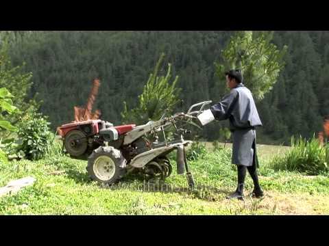 Bhutanese farmer moving a power tiller in Bumthang District of Bhutan