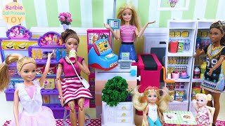 The dolls visited Barbie's small supermarket and bought a lot of food!