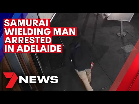 Police officer crash tackles man wielding samurai sword in Adelaide CBD | 7NEWS
