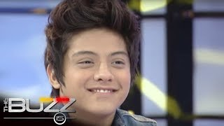 The Buzz Uncut : Daniel gives Kathryn a electric bass