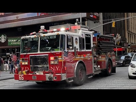 Download FDNY ENGINE 65 RESPONDING ON WEST 43RD STREET IN THE TIMES SQUARE AREA OF MANHATTAN IN NEW YORK CITY
