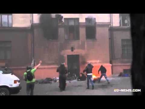 Odessa, Ukraine, 2.5.2014: People jumping out of burning building are beaten to death