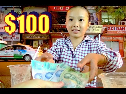 Giving $100 USD to a Vietnamese child worker. Saigon.