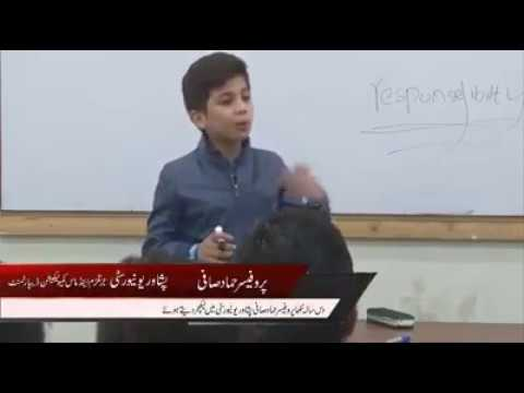 Grade 5 student giving motivational talk in the University of Peshawar.