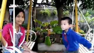 "Jewel Sky and Journey Star enjoying the ""swing"" in the backyard"