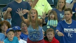 Kid snags souvenir from lady at the ballgame