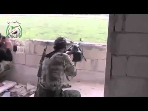 syriawarnews-Syrian Rebel With Machine Gun Shooting Blindly Syria War 2013 Syria war