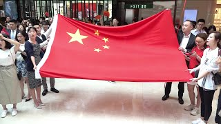 Hong Kong citizens gather to sing national anthem in shopping mall