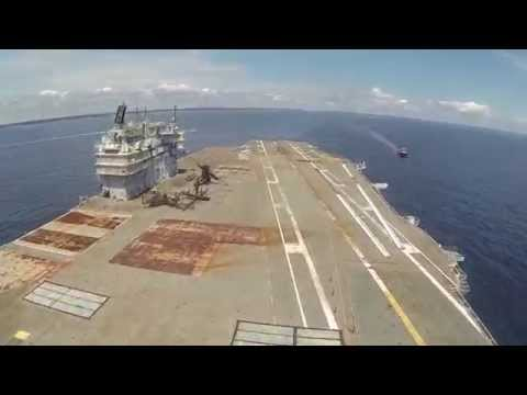 USS Saratoga begins her final voyage with one last fixed wing carrier take off / landing.