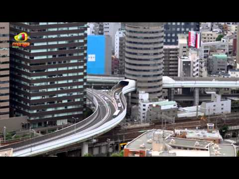 Gate Tower Highway that goes through the building   Japan   Wonders of World
