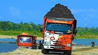 Super Overloaded Dump Trucks Moving Sands By Kobelco SK200 Excavator