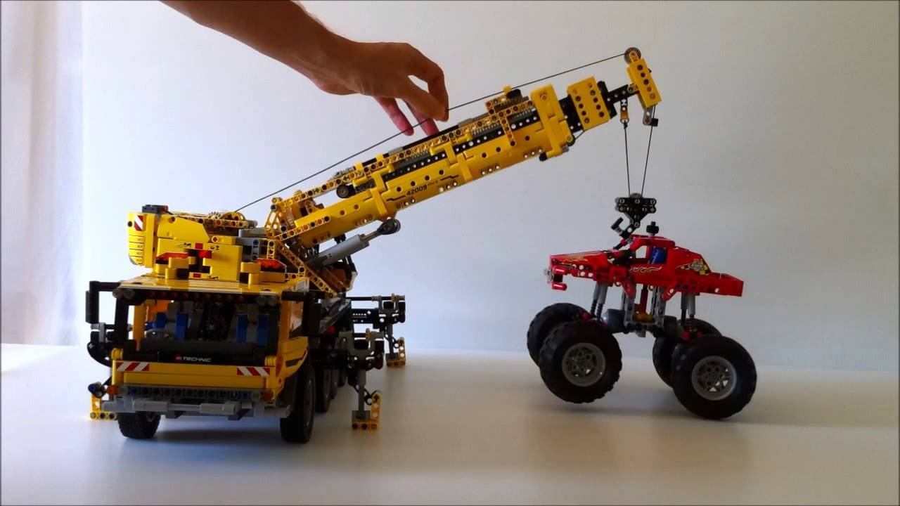 Lego technic 42005 monster truck being lifted by 42009 mobile crane