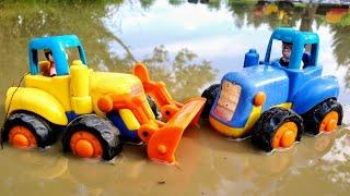 Синий трактор едет по дороге, по лужам. Детские мультики.