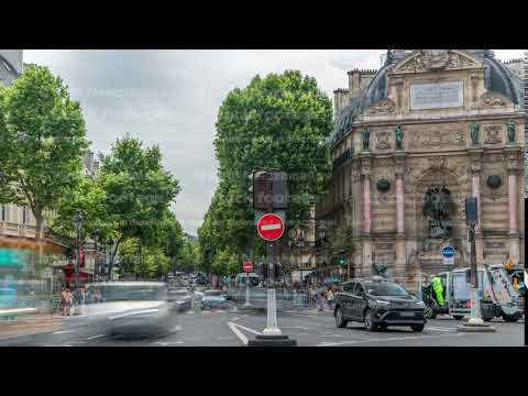 Street view of Place Saint-Michel with ancient fountain timelapse, Paris