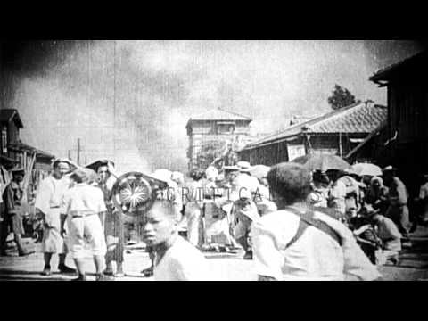 Japanese gather belongings and flee fire during the Great Kanto Earthquake of 192...HD Stock Footage
