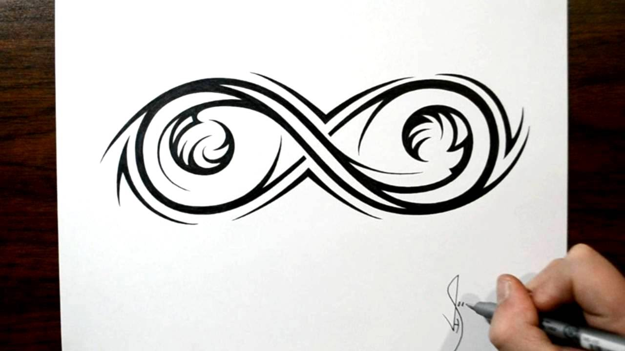 drawing an elaborate infinity symbol - tribal tattoo design style