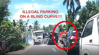Illegal parking on a blind curve causes an accident
