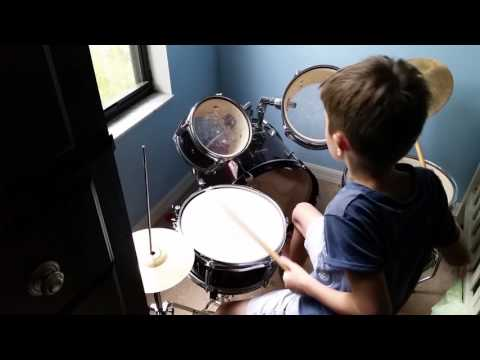 My 8 year old son playing on his Ludwig jr drums set