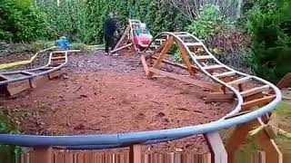 This man built a rollercoaster in his backyard for his grandchildren