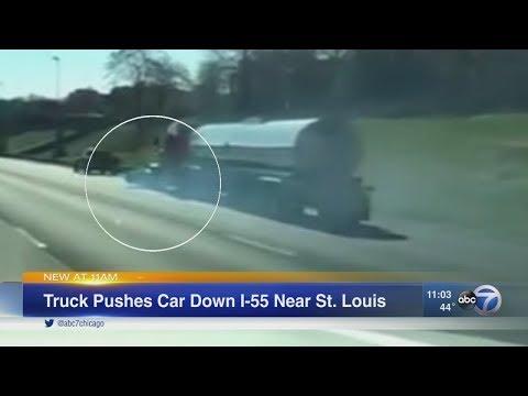 Semi pushes car down I-55