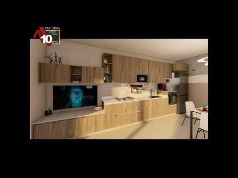 CUCINA LUNGA E STRETTA VISIBILE CON TAVOLO E ZONA TV