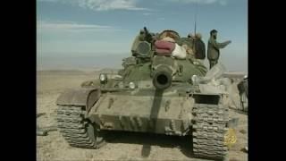 أرشيف- القوات الأميركية وتحالف الشمال يقصفان قاعدة تورا بورا